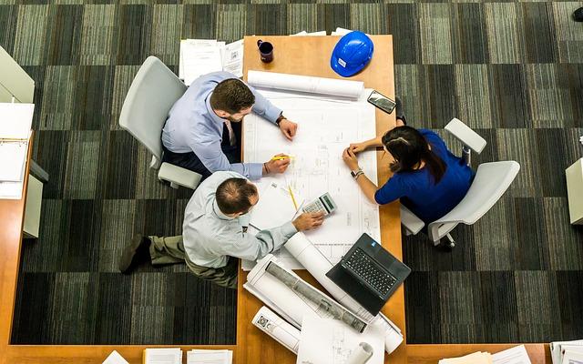 3 business people in meeting