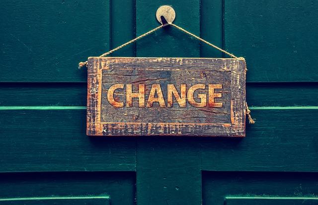 change sign hanging on wooden door